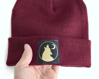 d56b50f0794 Soft Wolf Hat Beanie In Maroon With Gold Printed Wolf Moon Patch