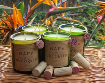 Candles made out of recycled wine bottles....Wine scented