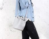 Saq bag light grey bucket bag crossbody shoulder pouch sac purse drawstring vegan faux leather two pockets with zipper simple everyday
