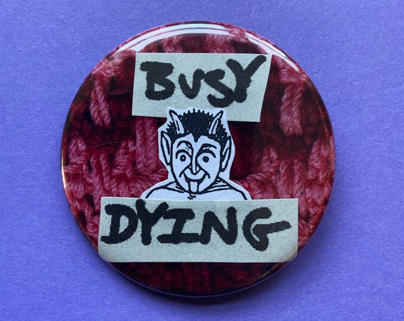 """2.25"""" Collaged Handmade Pinback Button - Red Devil Saying """"Busy Dying"""" Large Round Fun Layered Button - Big Upcycled Paper Wearable Artwork"""