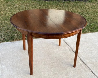 Danish Rosewood Mid Century Modern, C. 1960s, Extendable Round to Oval Dining Table with Two Leaves
