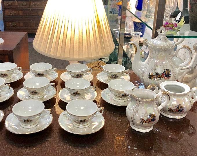 Veritable Porcelaine 25-piece Lusterware Tea Set, Tea Pot, Creamer and Sugar, 11 Demitasse Cups and Saucers, Horse and Carriage Decoration