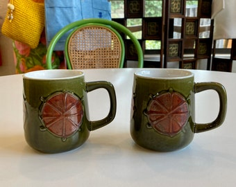 Pair of Mid-Century Glazed Pottery Mugs in Olive with Abstract Rust Designs