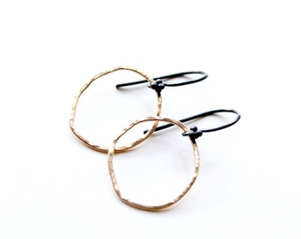 Mixed metal earrings, Organic shape gold hoops and oxidized sterling silver. Hammered gold hoops,jewelry trends 2018.Black and gold earrings