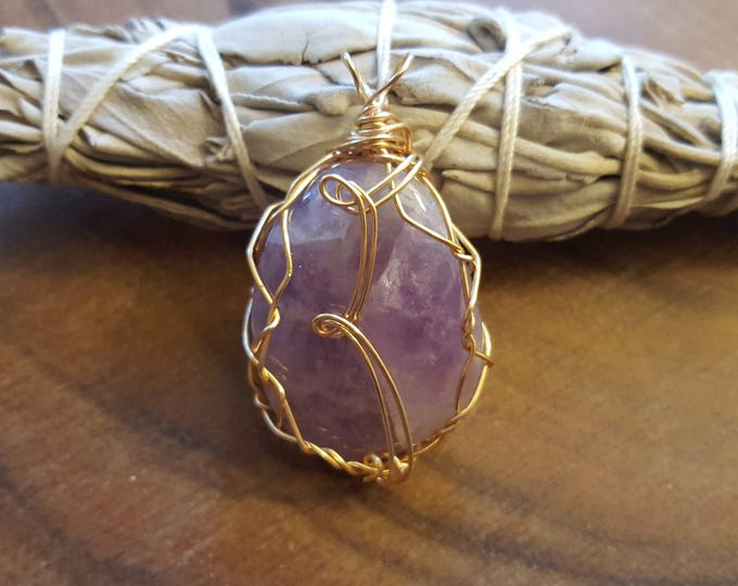 Amethyst in gold colored silver plated copper wire wrapped pendant, Reiki infused approx 1.9x1.1 inches (WW35)