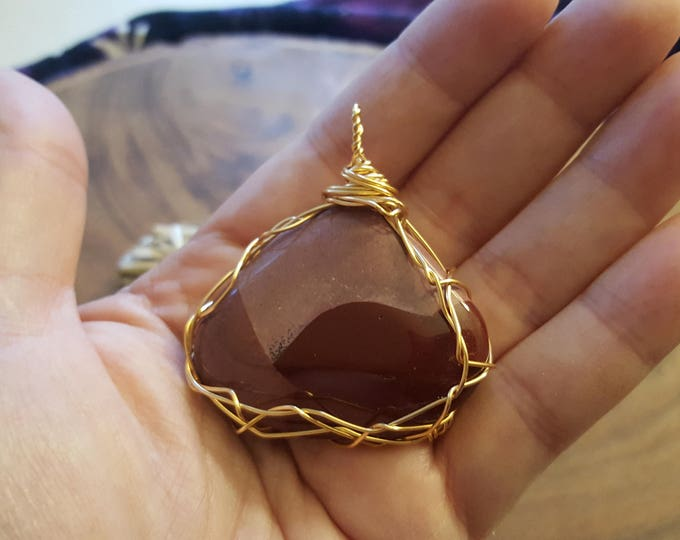 Purple Mookite (mookaite) in gold colored copper wire wrapped pendant, Reiki infused approx 1.9x1.8 inches (WW39)