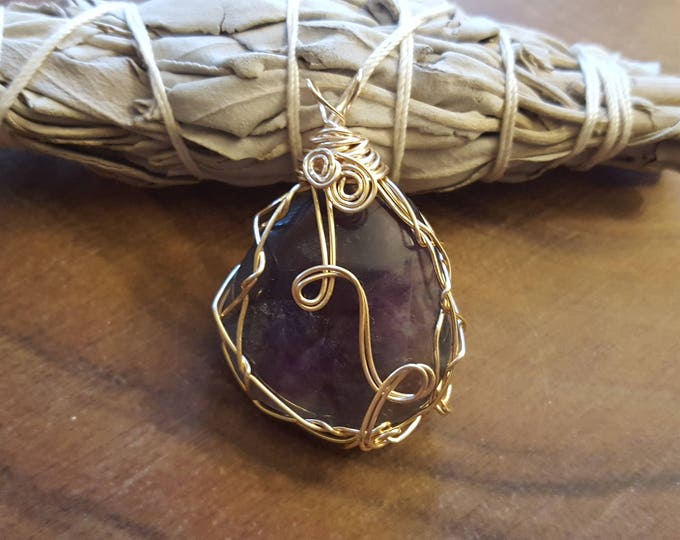 Rainbow Fluorite in gold colored silver plated copper wire wrapped pendant, Reiki infused approx 1.8x1.3 inches (WW36)
