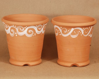 Hand Thrown Terracotta Planters.  Set of two.  2# full pot with decoration.  5.5 inches tall and 5.5 inches wide.