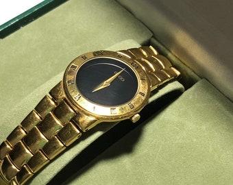 be890562b0c Vintage 90s Gucci 18K Gold Plated Quartz Watch Black Face
