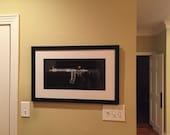 "27"" x 17"" custom black frame with black core, white mat, & hanging hardware"