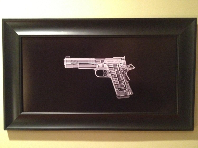 TAC listo al marco de la pistola 1911
