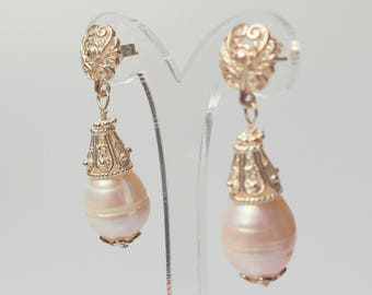 Silver ear with large pearl drops and and richly processed silver beads
