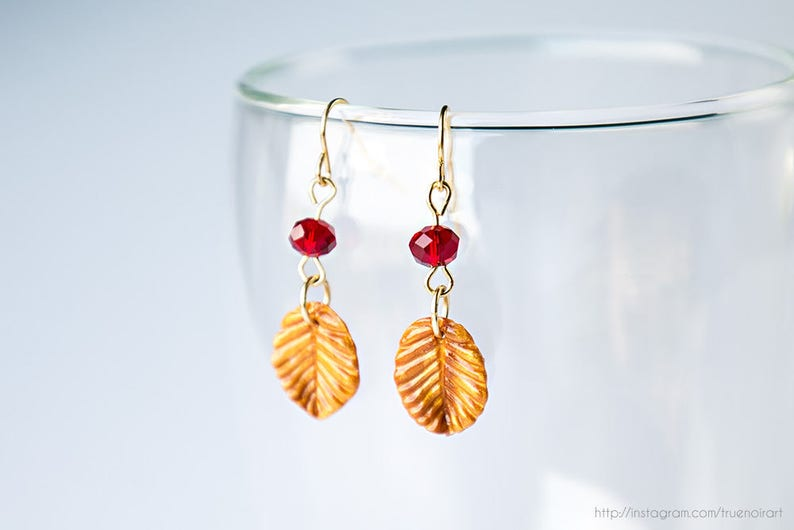 Golden leaf earrings with red glass bead Nature inspired image 0