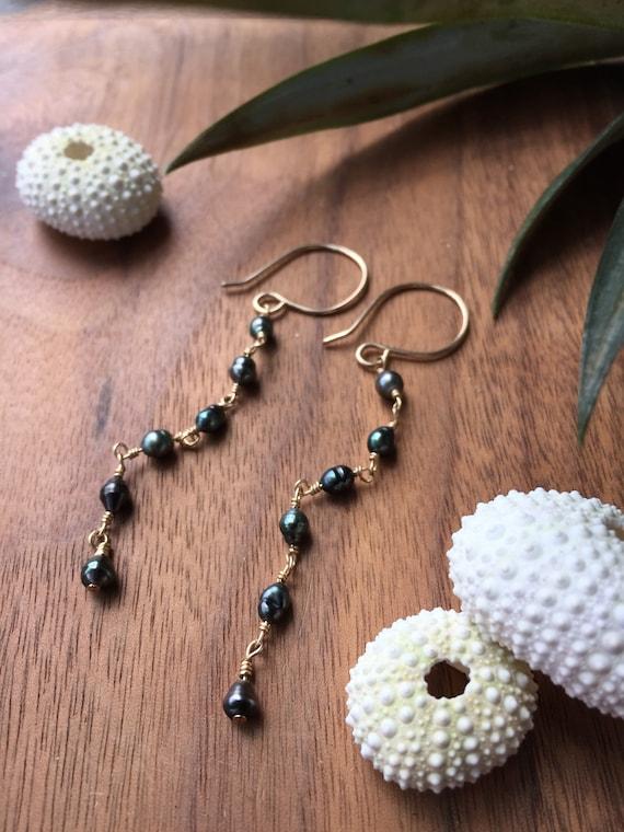 Moana dangle earrings