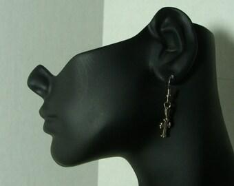 Silver cross earrings.