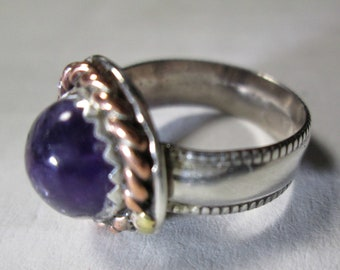 Ring, sterling silver with an Amethyst... size 6 1/2