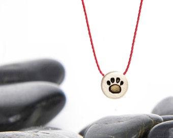 Tiny Sliding Charm Necklace in Brass