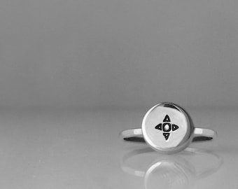 This is my Small Compass Charm Ring in Sterling Silver
