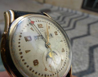 Movado Triple Date Moonphase. Cal. 473.