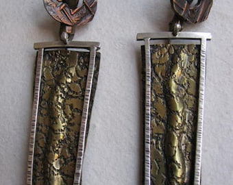 Sterling silver, brass and copper One of a Kind, snake and coin earrings with hands