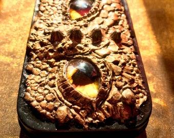 "Golden dragon eyeball tin (2.25""x3.5""x1""), original artwork"