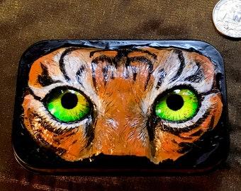 "Large tiger eyeball tin (2.25""x3.5""x1""), original artwork"