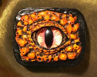 "Small orange dragon eyeball tin (1.75""x2.25""x1""), original artwork"