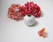 opal white glaze round windowsill vase / porcalain bud vase from echo of nature , yumiko goto