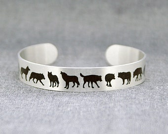Wolf jewellery, brushed silver cuff bracelet, metal bangle with wolves in black. Dogs ancestors. Wildlife gift. S500