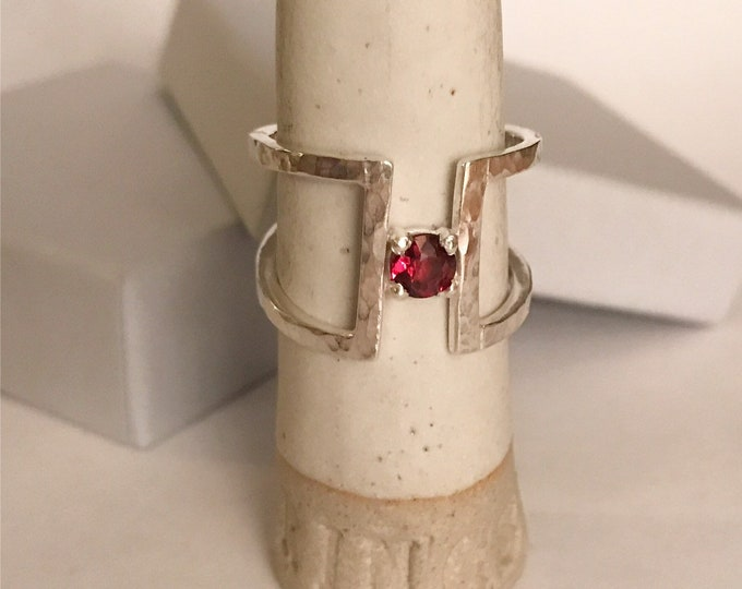 Wide hammered finish statement ring with garnet