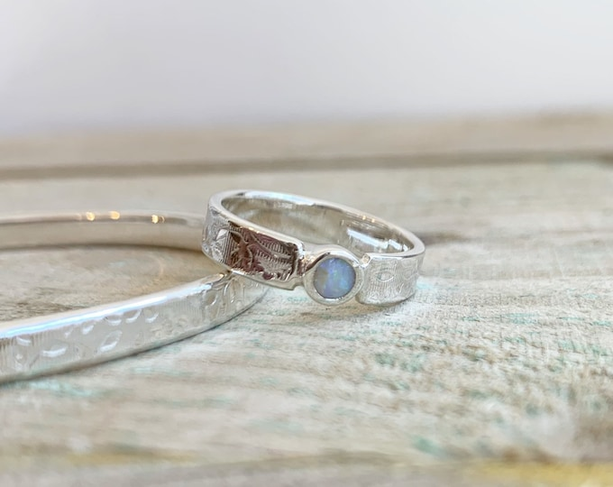Textured ring with opal in sterling silver