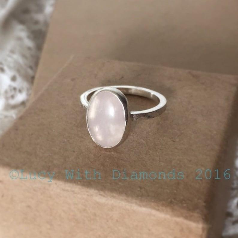 Large oval rose quartz ring on hammered sterling silver band stackable