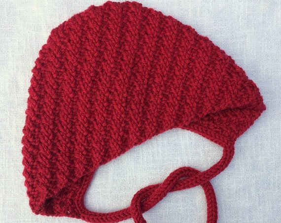 Corran Baby Bonnet - Ruby Red - Sizes 0-3, 3-6, 6-12 & 12-24 months
