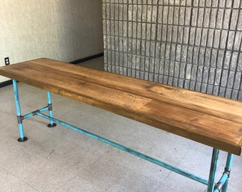Reclaimed wood desk with turquoise distressed metal pipe table legs