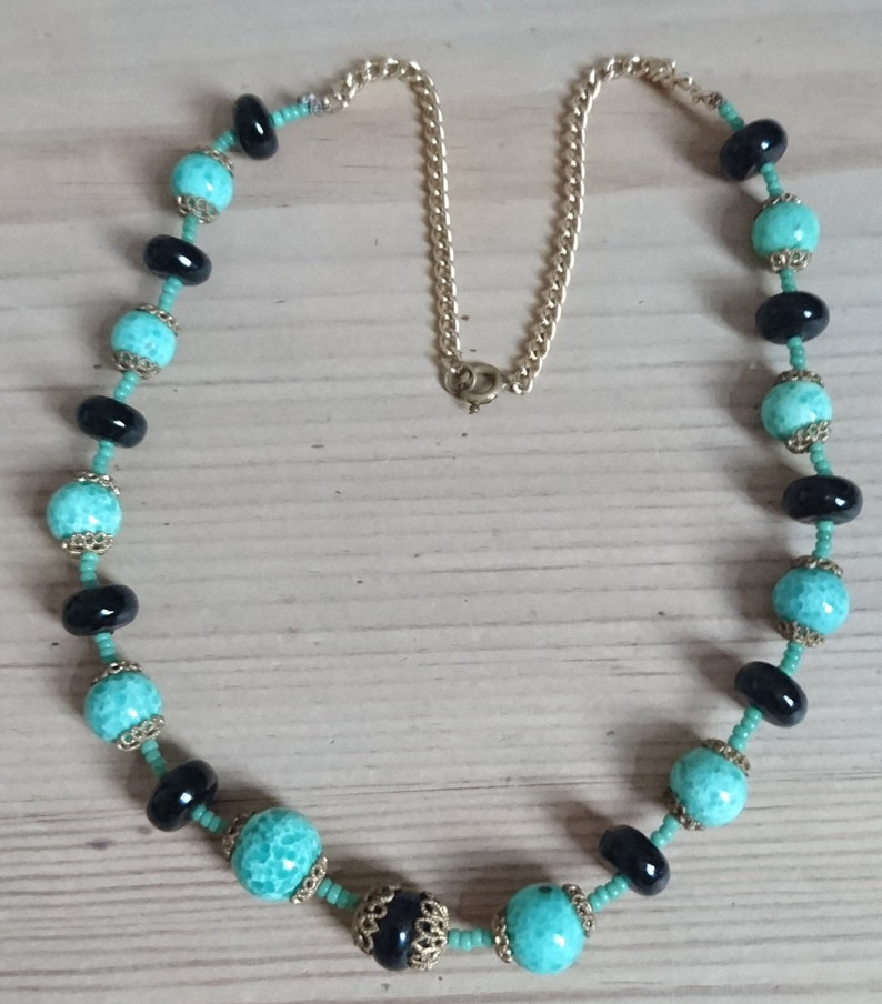 Vintage green and black glass bead necklace