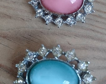 Vintage pink and blue rhinestone brooches