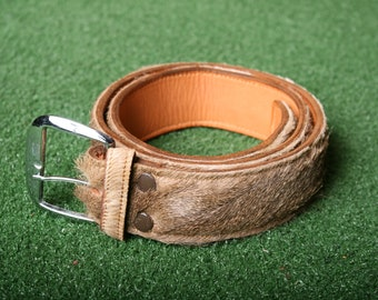 The belt is 100/% leather the buckle is bronze and engraved in the middle from the horn LIMITED EDITION
