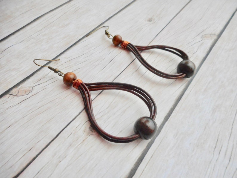 Leather straps earrings brown wooden beads ladies jewelry image 0