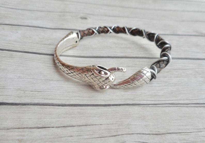 5cc9e6bd9de Ouroboros armband gevlochten leer heren dames bruine sieraad | Etsy