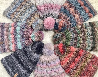 Colourful hand knitted cable pom pom hat. Women's thick chunky bobble beanie. Various colours, variegated yarn, textured winter accessory.