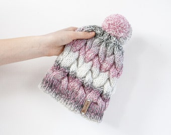 Colourful hand knitted cable pom pom hat. Women's thick chunky bobble beanie. Dark Pink/Grey mix, variegated yarn, textured winter accessory