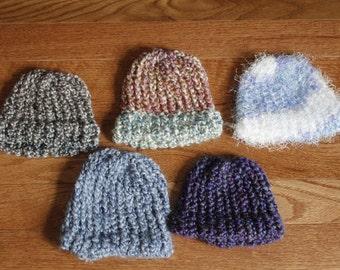 Newborn sized knit hats