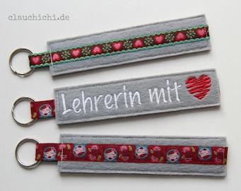 """Schlüsselanhänger """"Lehrerin mit Herz"""" (grau)"""