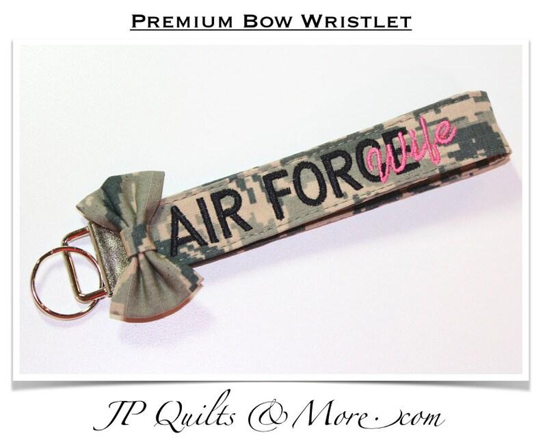 Premium Bow Wristlet in ABU Material image 0