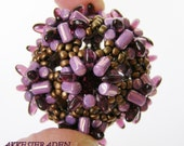 English pattern for the  Big rulla air ball with rizo beads or spikes or triangles