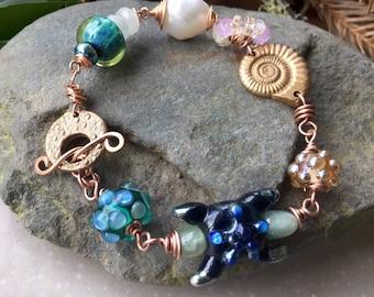 Mermaids Purse,special lampwork,bronze and pearl bracelet