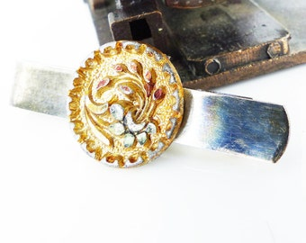 Brass patina slip style Tie Bar. Antique Victorian brass & cut steel floral embellishment tinted in copper. Incredible little piece of art