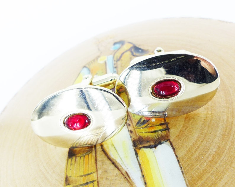 Gold setting with polished red glass center design Vintage oval cufflinks Classic Don Draper
