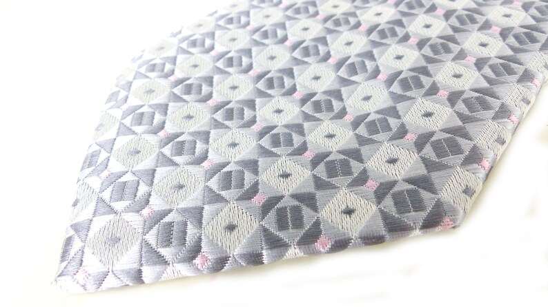Classic /& beautiful Jon Vandyk woven silk necktie in several shades of gray with little pink square details Hand made in Holland.