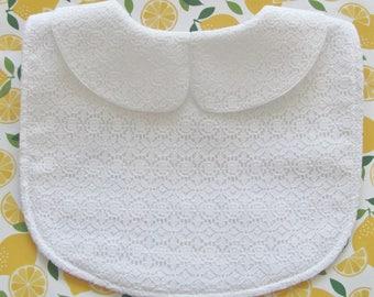 Collared white lace bib